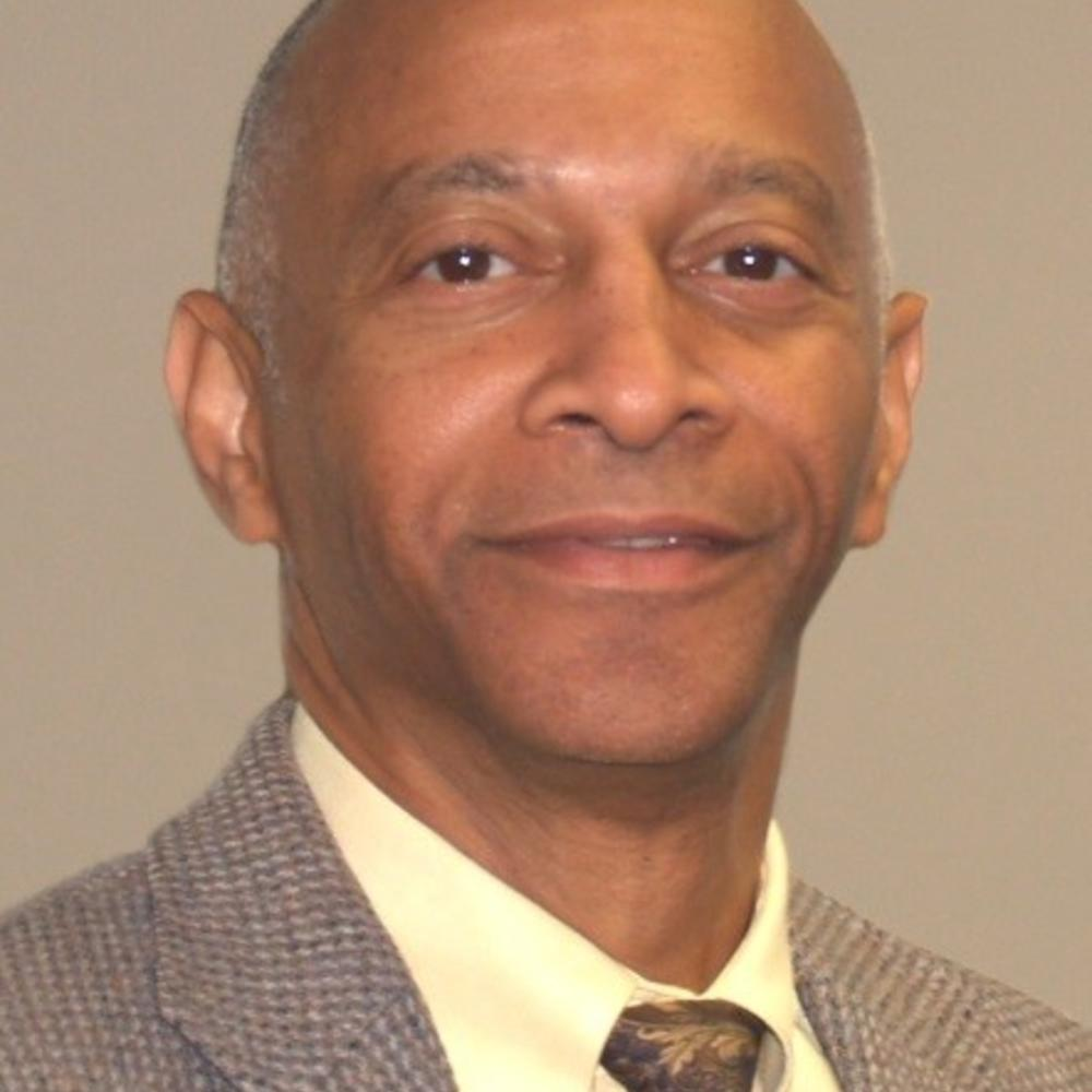 Dr. Emile Risby headshot